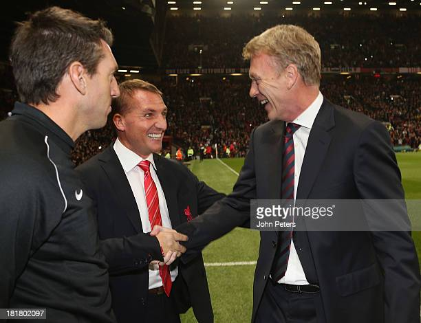 Manager David Moyes of Manchester United greets Brendan Rodgers of Liverpool ahead of the Capital Cup Third Round match between Manchester United and...