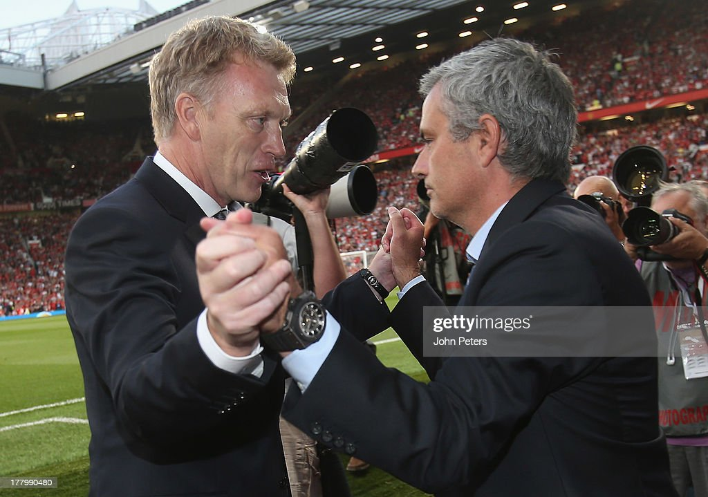 Manager <a gi-track='captionPersonalityLinkClicked' href=/galleries/search?phrase=David+Moyes&family=editorial&specificpeople=215482 ng-click='$event.stopPropagation()'>David Moyes</a> of Manchester United greets manager Jose Mourinho of Chelsea ahead of the Barclays Premier League match between Manchester United and Chelsea at Old Trafford on August 26, 2013 in Manchester, England.