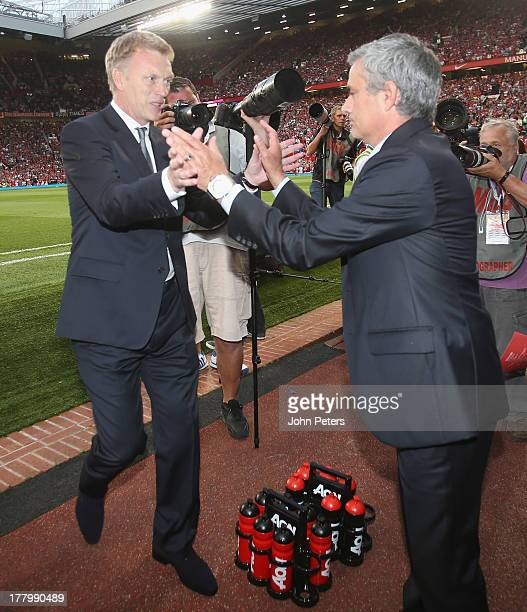 Manager David Moyes of Manchester United greets manager Jose Mourinho of Chelsea ahead of the Barclays Premier League match between Manchester United...