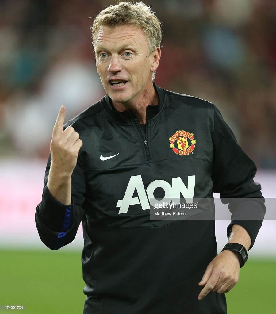 Manager <a gi-track='captionPersonalityLinkClicked' href=/galleries/search?phrase=David+Moyes&family=editorial&specificpeople=215482 ng-click='$event.stopPropagation()'>David Moyes</a> of Manchester United in action during a first team training session as part of their pre-season tour of Bangkok, Australia, China, Japan and Hong Kong on July 19, 2013 in Sydney, Australia.