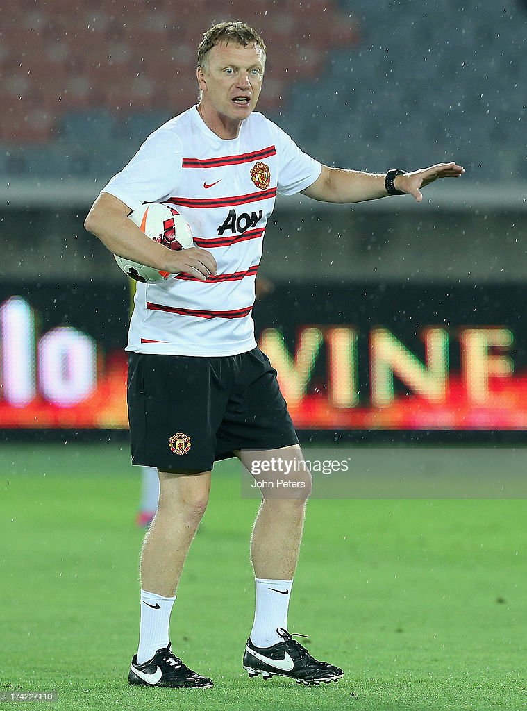 Manager <a gi-track='captionPersonalityLinkClicked' href=/galleries/search?phrase=David+Moyes&family=editorial&specificpeople=215482 ng-click='$event.stopPropagation()'>David Moyes</a> of Manchester United in action during a first team training session as part of their pre-season tour of Bangkok, Australia, China, Japan and Hong Kong on July 22, 2013 in Yokohama, Japan.