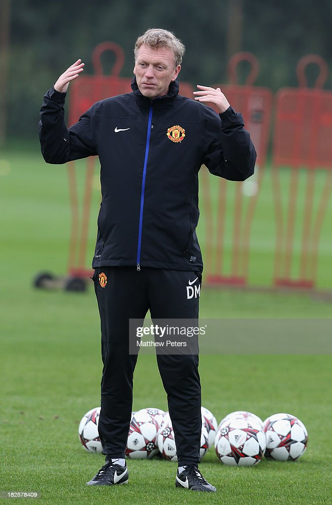 Manager <a gi-track='captionPersonalityLinkClicked' href=/galleries/search?phrase=David+Moyes&family=editorial&specificpeople=215482 ng-click='$event.stopPropagation()'>David Moyes</a> of Manchester United in action during a first team training session, ahead of their UEFA Champions League match against Shaktar Donetsk, at Aon Training Complex on October 1, 2013 in Manchester, England.