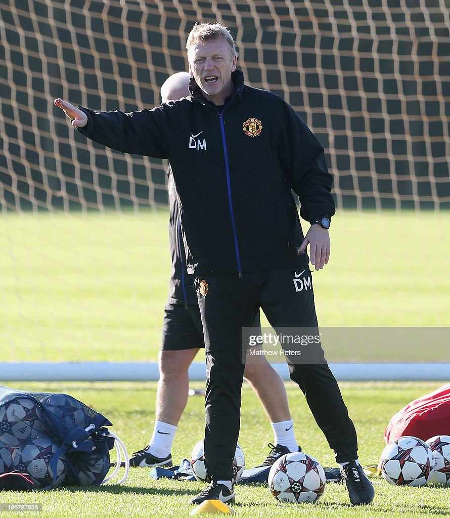 Manager <a gi-track='captionPersonalityLinkClicked' href=/galleries/search?phrase=David+Moyes&family=editorial&specificpeople=215482 ng-click='$event.stopPropagation()'>David Moyes</a> of Manchester United in action during a first team training session, ahead of their UEFA Champions League Group A match against Real Sociedad, at the Aon Training Complex on November 4, 2013 in Manchester, England.