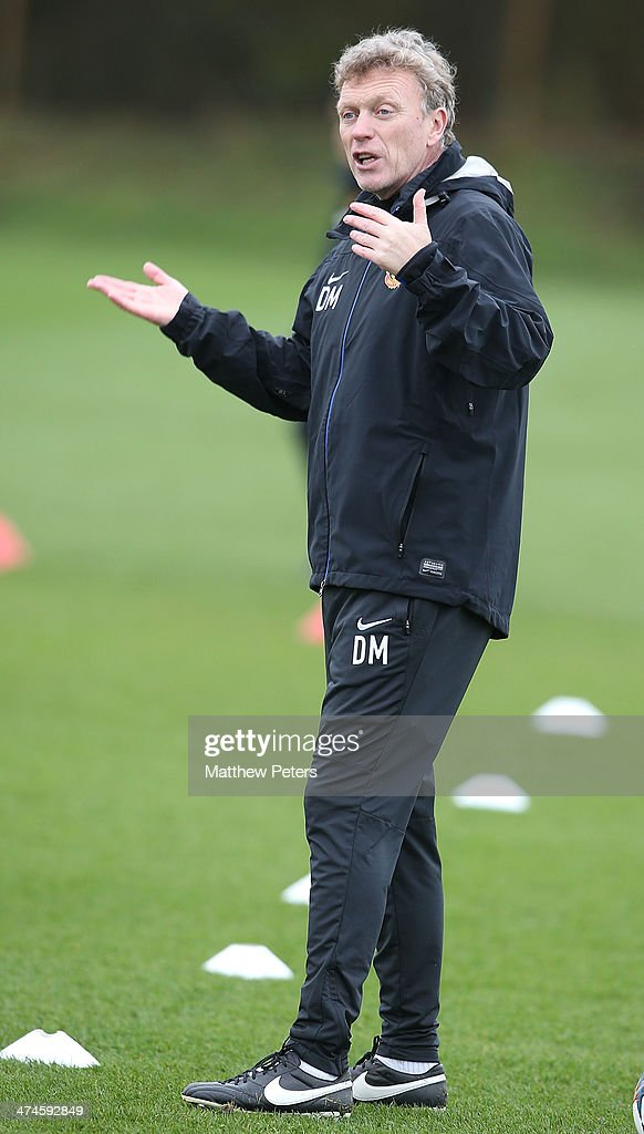 Manager <a gi-track='captionPersonalityLinkClicked' href=/galleries/search?phrase=David+Moyes&family=editorial&specificpeople=215482 ng-click='$event.stopPropagation()'>David Moyes</a> of Manchester United in action during a first team training session, ahead of their UEFA Champions League Round of 16 match against Olympiacos, at Aon Training Complex on February 24, 2014 in Manchester, England.