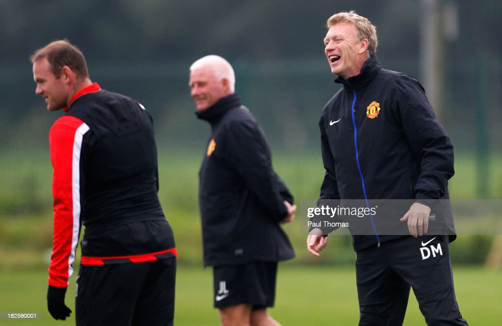 Manager David Moyes (R) of Manchester United laughs during a training session ahead of their Champions League Group A match against Shakhtar Donetsk at their Carrington Training Complex on October 01, 2013 in Manchester, England