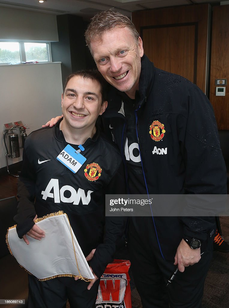 Manager <a gi-track='captionPersonalityLinkClicked' href=/galleries/search?phrase=David+Moyes&family=editorial&specificpeople=215482 ng-click='$event.stopPropagation()'>David Moyes</a> of Manchester United meets Adam Calow during a Manchester United Foundation Dream Day, for fans with life-limiting illnesses, at Aon Training Complex on October 28, 2013 in Manchester, England.
