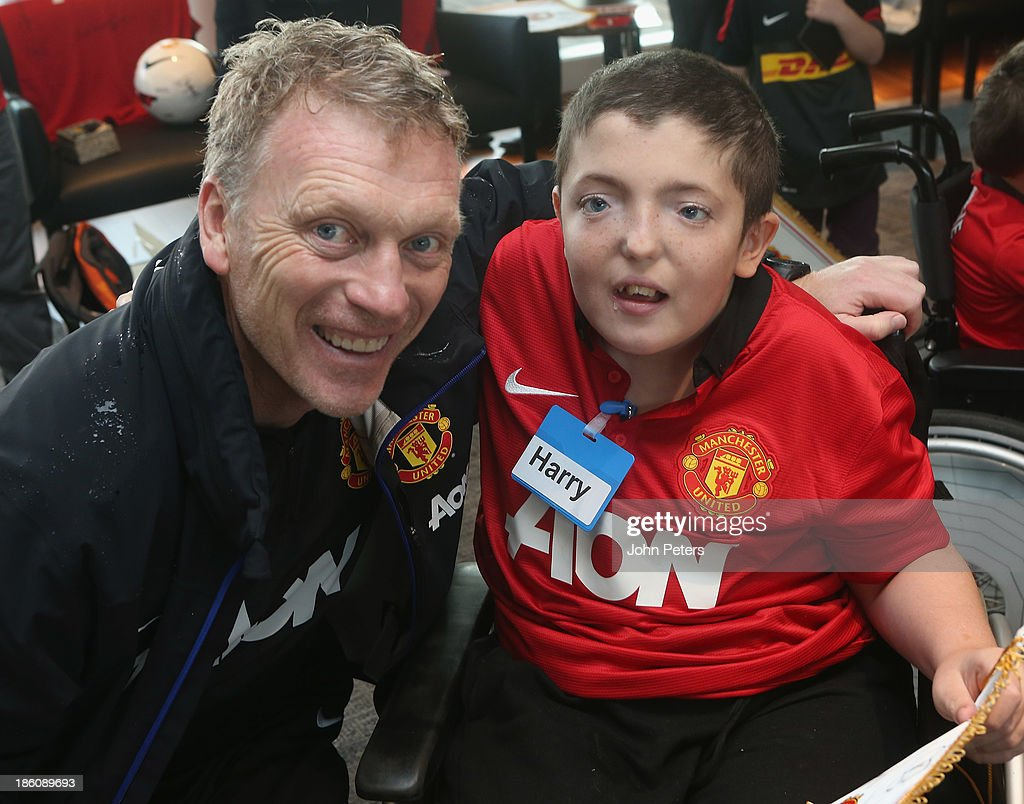 Manager <a gi-track='captionPersonalityLinkClicked' href=/galleries/search?phrase=David+Moyes&family=editorial&specificpeople=215482 ng-click='$event.stopPropagation()'>David Moyes</a> of Manchester United meets Harry during a Manchester United Foundation Dream Day, for fans with life-limiting illnesses, at Aon Training Complex on October 28, 2013 in Manchester, England.