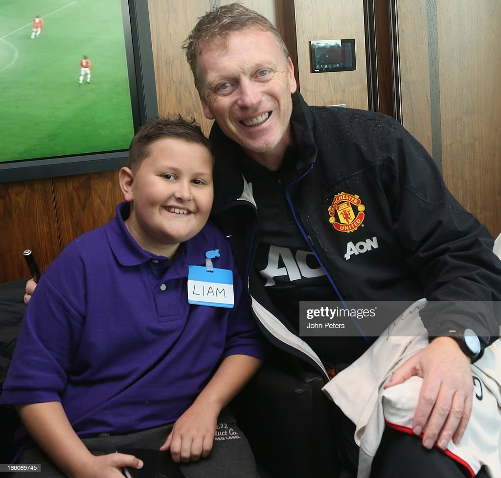Manager David Moyes of Manchester United meets Liam during a Manchester United Foundation Dream Day, for fans with life-limiting illnesses, at Aon Training Complex on October 28, 2013 in Manchester, England.