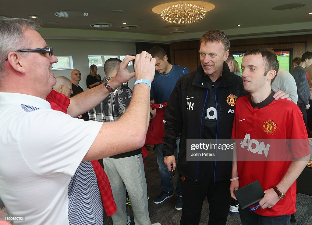 Manager David Moyes of Manchester United meets Luke Bramwell during a Manchester United Foundation Dream Day, for fans with life-limiting illnesses, at Aon Training Complex on October 28, 2013 in Manchester, England.