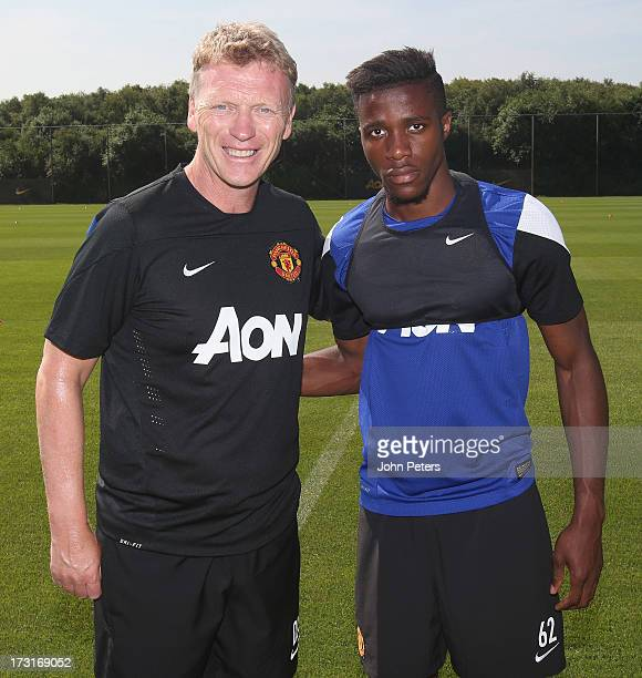 Manager David Moyes of Manchester United poses with Wilfried Zaha ahead of a first team training session at the Aon Training Complex on July 9 2013...