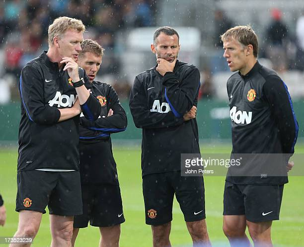 Manager David Moyes of Manchester United speaks to Assistant Manager Steve Round Ryan Giggs and Coach Phil Neville during a first team training...