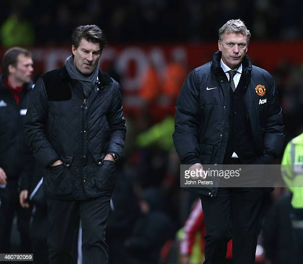 Manager David Moyes of Manchester United walks off after during the FA Cup Third Round match between Manchester United and Swansea City at Old...