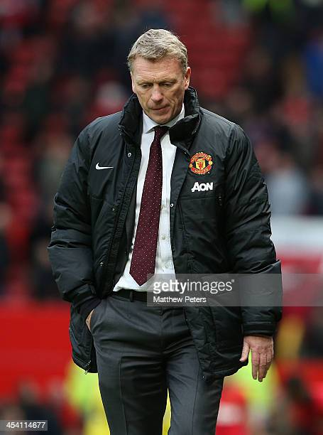 Manager David Moyes of Manchester United walks off after the Barclays Premier League match between Manchester United and Newcastle United at Old...