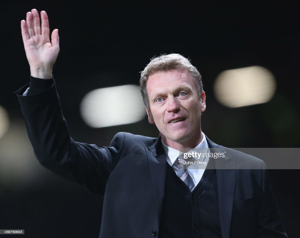 Manager <a gi-track='captionPersonalityLinkClicked' href=/galleries/search?phrase=David+Moyes&family=editorial&specificpeople=215482 ng-click='$event.stopPropagation()'>David Moyes</a> of Manchester United walks off after the Barclays Premier League match between Manchester United and West Ham United at Old Trafford on December 21, 2013 in Manchester, England.