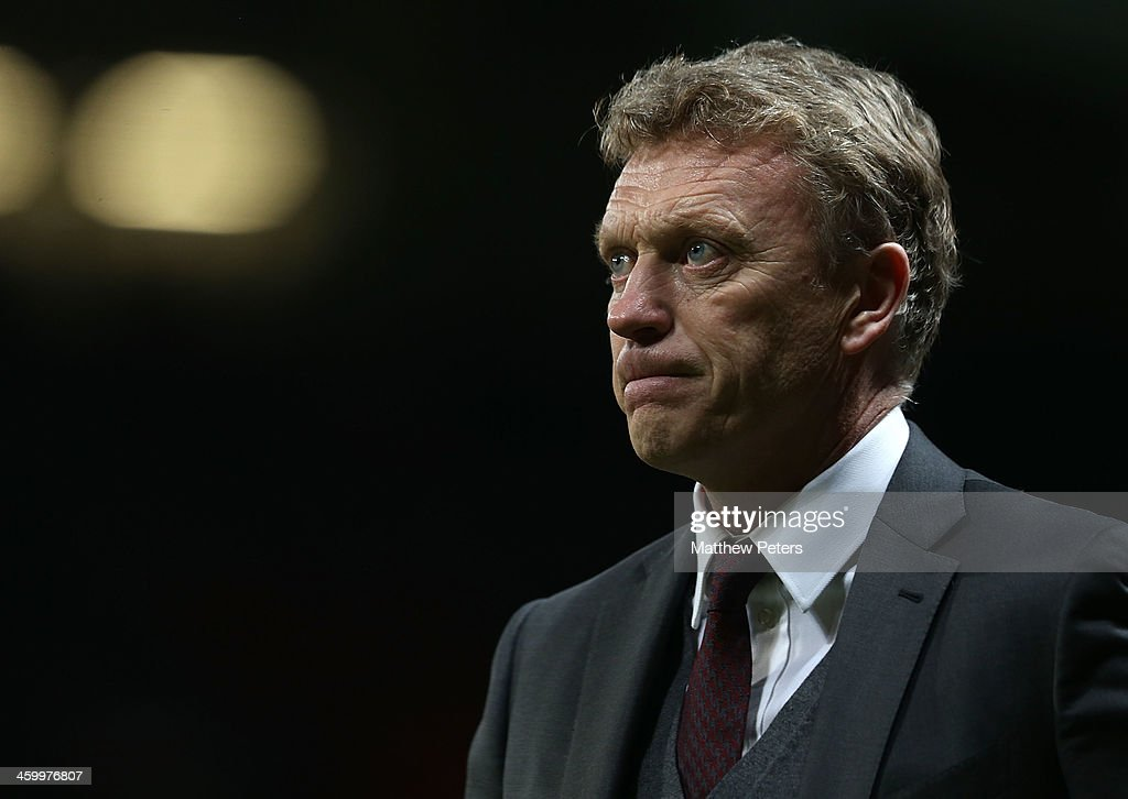Manager David Moyes of Manchester United walks off after the Barclays Premier League match between Manchester United and Tottenham Hospur at Old Trafford on January 1, 2014 in Manchester, England.