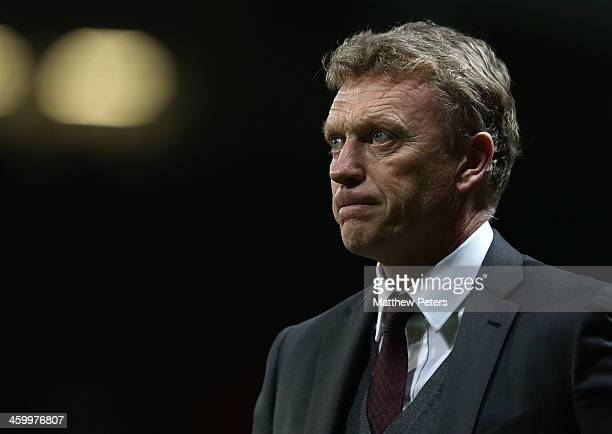 Manager David Moyes of Manchester United walks off after the Barclays Premier League match between Manchester United and Tottenham Hospur at Old...