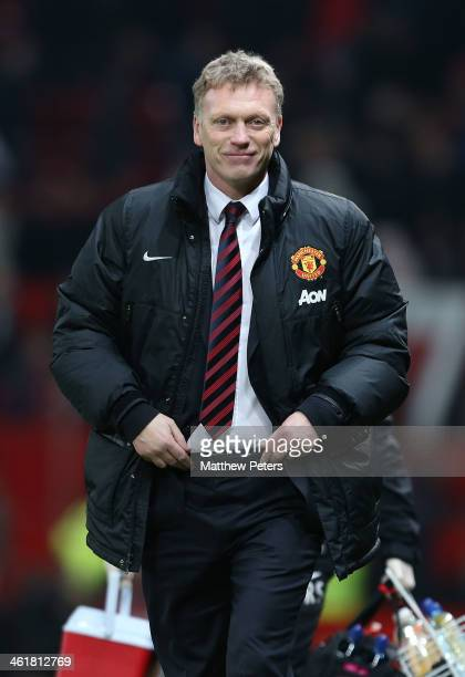 Manager David Moyes of Manchester United walks off after the Barclays Premier League match between Manchester United and Swansea City at Old Trafford...