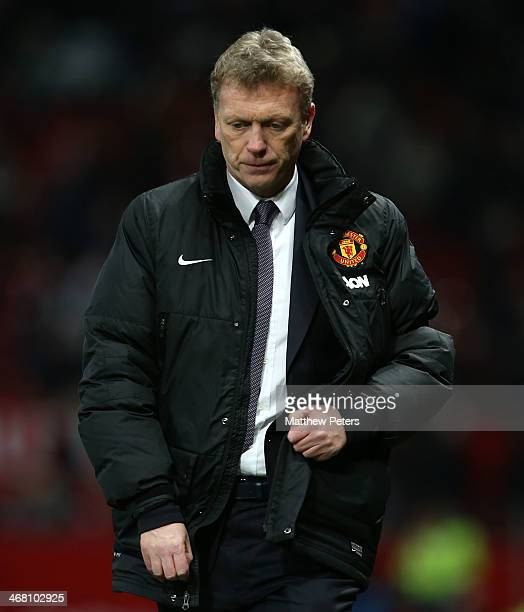 Manager David Moyes of Manchester United walks off after the Barclays Premier League match between Manchester United and Fulham at Old Trafford on...