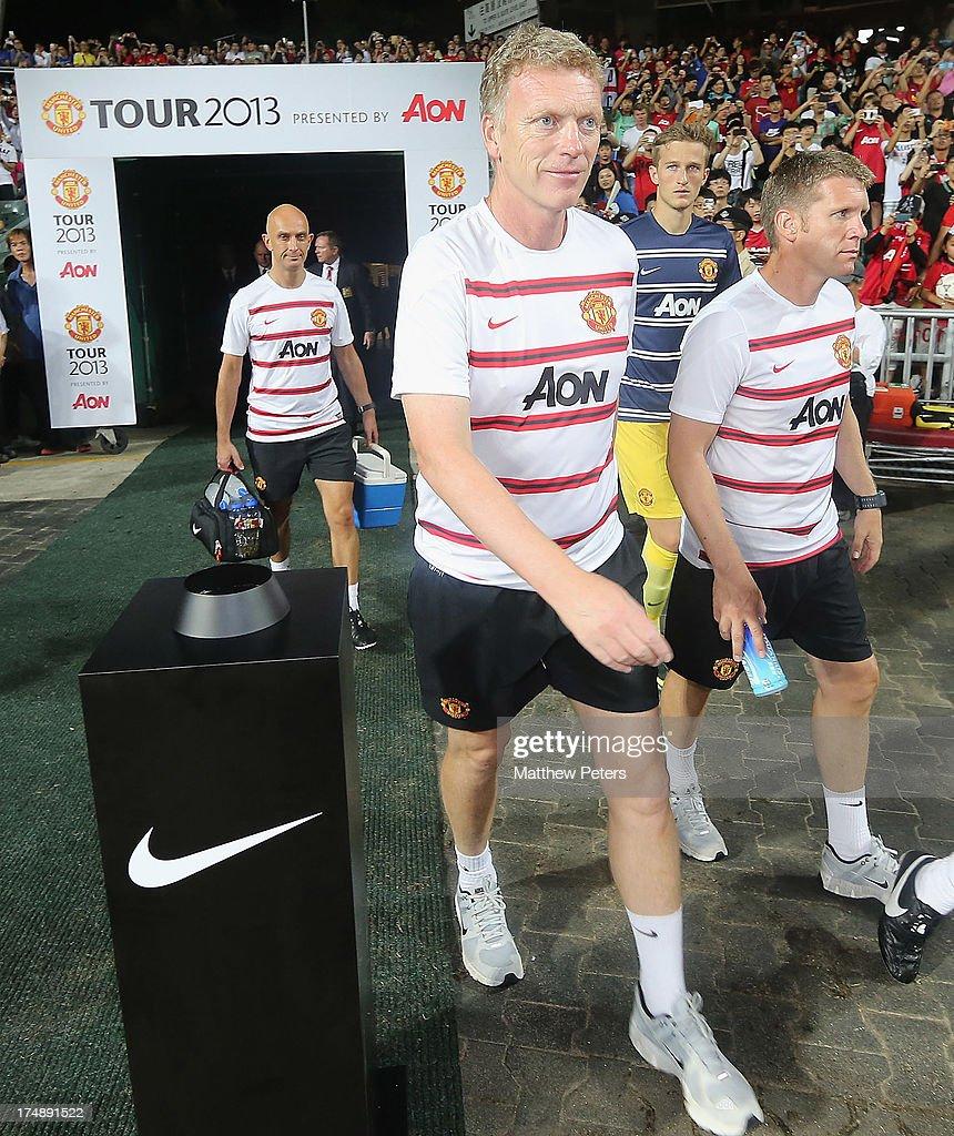 Manager David Moyes of Manchester United walks out ahead of the pre-season friendly match between Kitchee FC and Manchester United as part of their pre-season tour of Bangkok, Australia, Japan and Hong Kong at Hong Kong Stadium on July 29, 2013 in So Kon Po, Hong Kong.