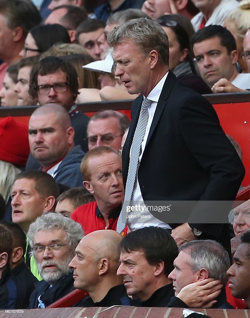 Manager <a gi-track='captionPersonalityLinkClicked' href=/galleries/search?phrase=David+Moyes&family=editorial&specificpeople=215482 ng-click='$event.stopPropagation()'>David Moyes</a> of Manchester United watches from the dugout during the Barclays Premier League match between Manchester United and West Bromwich Albion at Old Trafford on September 28, 2013 in Manchester, England.