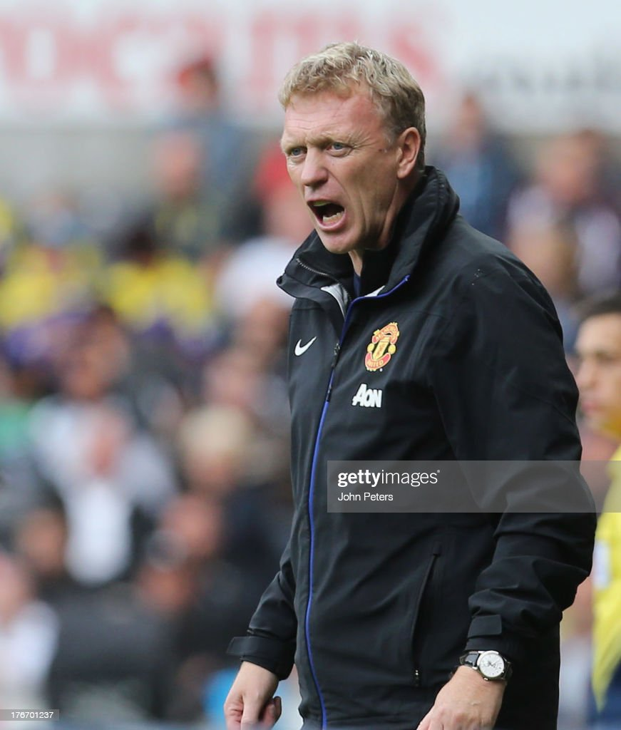 Manager <a gi-track='captionPersonalityLinkClicked' href=/galleries/search?phrase=David+Moyes&family=editorial&specificpeople=215482 ng-click='$event.stopPropagation()'>David Moyes</a> of Manchester United watches from the touchline during the Barclays Premier League match between Swansea City and Manchester United at the Liberty Stadium on August 17, 2013 in Swansea, Wales.