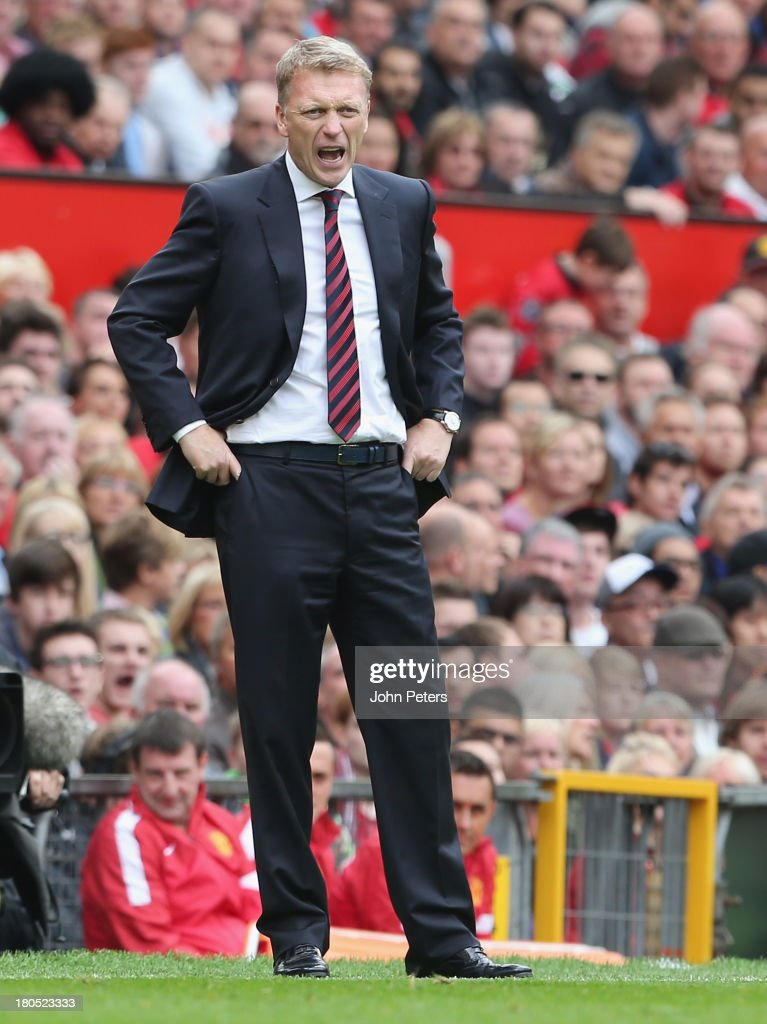 Manager <a gi-track='captionPersonalityLinkClicked' href=/galleries/search?phrase=David+Moyes&family=editorial&specificpeople=215482 ng-click='$event.stopPropagation()'>David Moyes</a> of Manchester United watches from the touchline during the Barclays Premier League match between Manchester United and Crystal Palace at Old Trafford on September 14, 2013 in Manchester, England.
