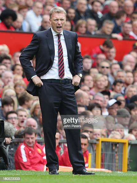 Manager David Moyes of Manchester United watches from the touchline during the Barclays Premier League match between Manchester United and Crystal...