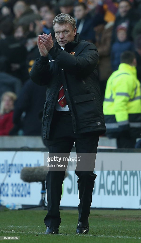 Manager David Moyes of Manchester United watches from the touchline during the Barclays Premier League match between Hull City and Manchester United at KC Stadium on December 26, 2013 in Hull, England.