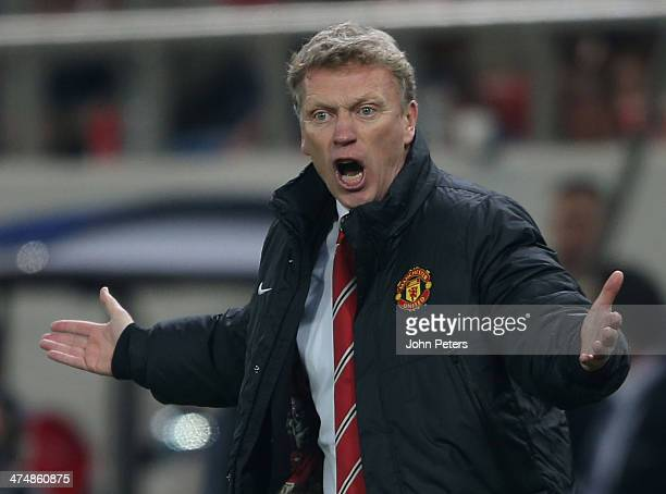 Manager David Moyes of Manchester United watches from the touchline during the UEFA Champions League Round of 16 match between Olympiacos FC and...