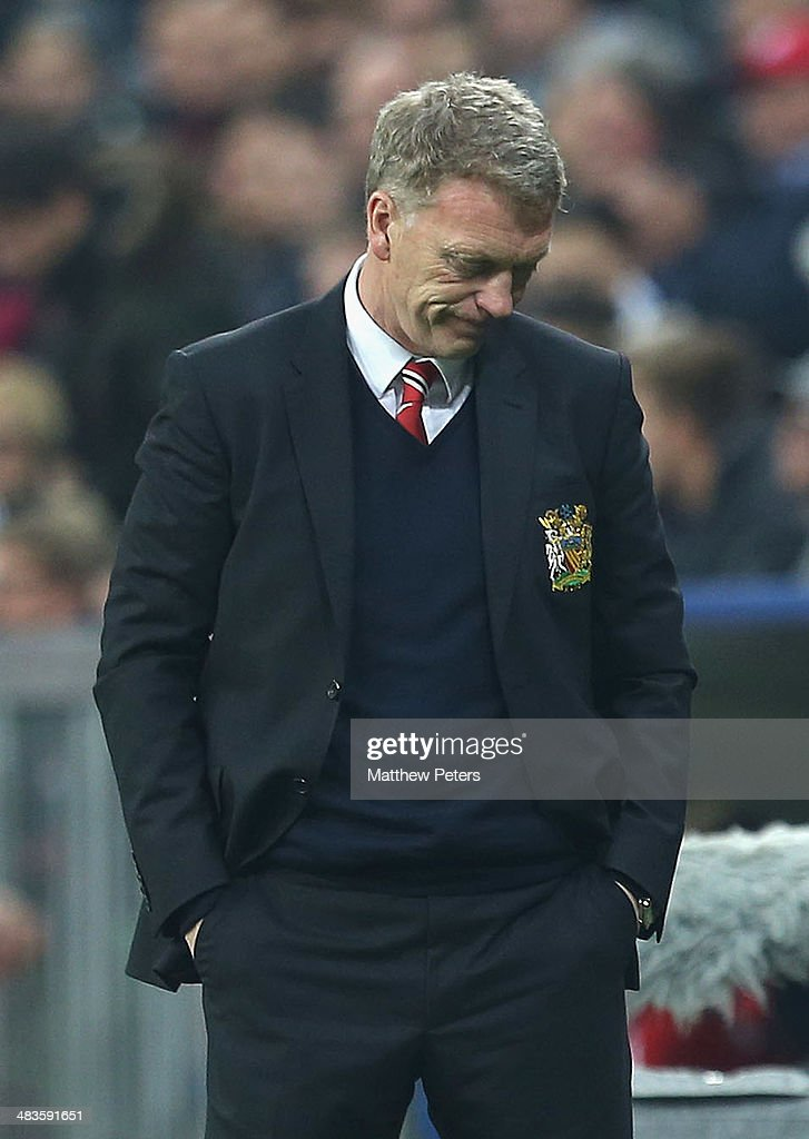 Manager <a gi-track='captionPersonalityLinkClicked' href=/galleries/search?phrase=David+Moyes&family=editorial&specificpeople=215482 ng-click='$event.stopPropagation()'>David Moyes</a> of Manchester United watches from the touchline during the UEFA Champions League quarter-final second leg match between Bayern Munich and Manchester United at Allianz Arena on April 9, 2014 in Munich, Germany.