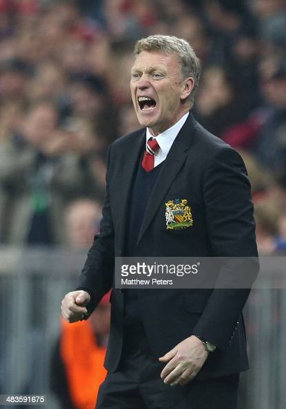 Manager David Moyes of Manchester United watches from the touchline during the UEFA Champions League quarterfinal second leg match between Bayern...