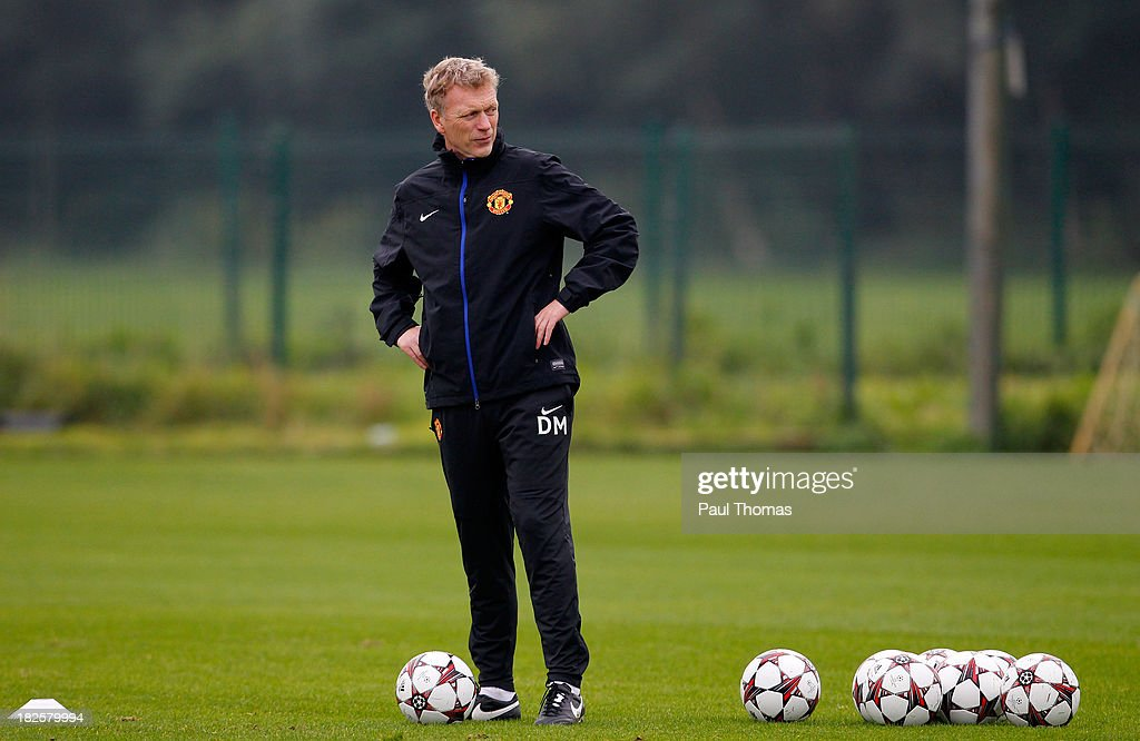Manager David Moyes of Manchester United watches his players during a training session ahead of their Champions League Group A match against Shakhtar Donetsk at their Carrington Training Complex on October 01, 2013 in Manchester, England