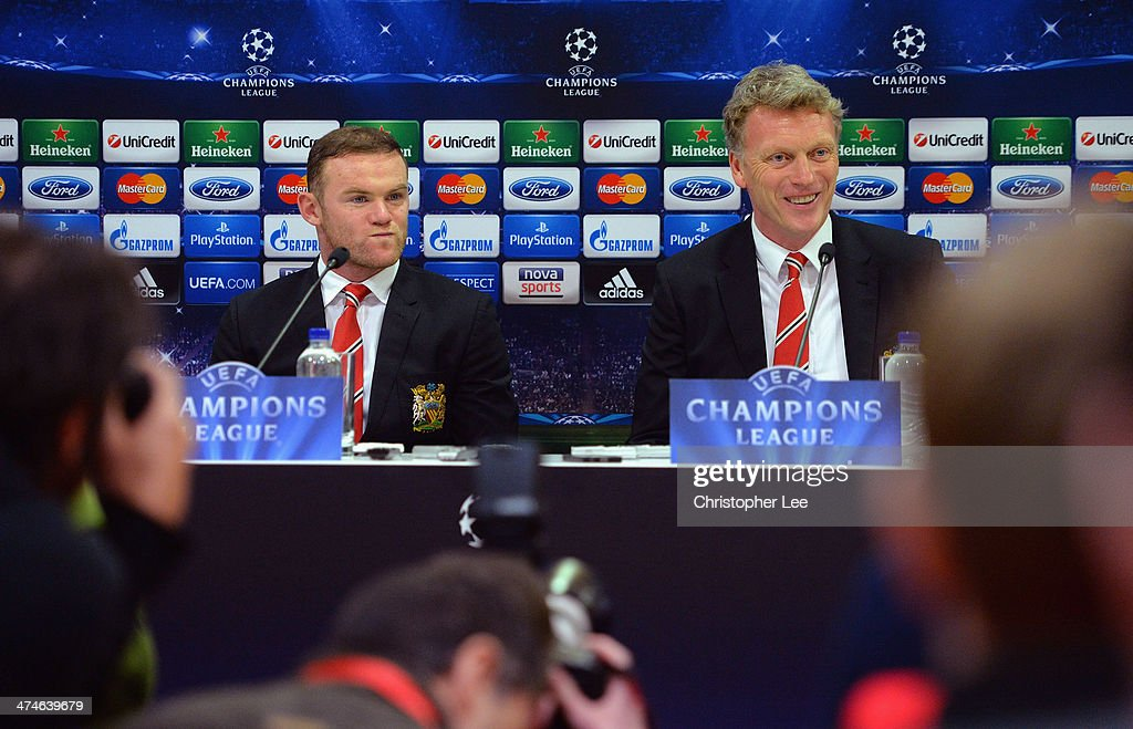Manager <a gi-track='captionPersonalityLinkClicked' href=/galleries/search?phrase=David+Moyes&family=editorial&specificpeople=215482 ng-click='$event.stopPropagation()'>David Moyes</a> (R) talks to the media as <a gi-track='captionPersonalityLinkClicked' href=/galleries/search?phrase=Wayne+Rooney&family=editorial&specificpeople=157598 ng-click='$event.stopPropagation()'>Wayne Rooney</a> (L) looks on during the Manchester United Press Conference at Karaiskakis Stadium on February 24, 2014 in Piraeus, Greece.