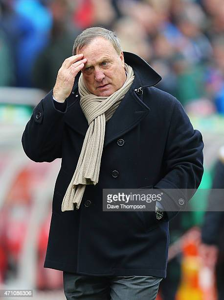 Manager Dick Advocaat of Sunderland looks on during the Barclays Premier League match between Stoke City and Sunderland at Britannia Stadium on April...