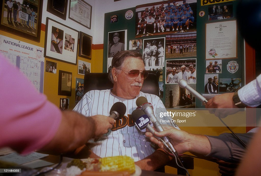 Manager Dick Williams of the San Diego Padres is being interviewd by the press after a Major League Baseball game circa 1985 in his office at Jack...
