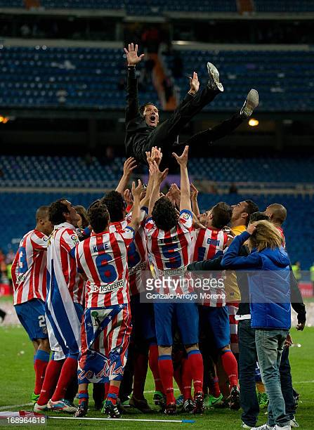 Manager Diego Pablo Simeone of Atletico de Madrid is held in the air by his teammates after winning the Copa del Rey Final match between Real Madrid...
