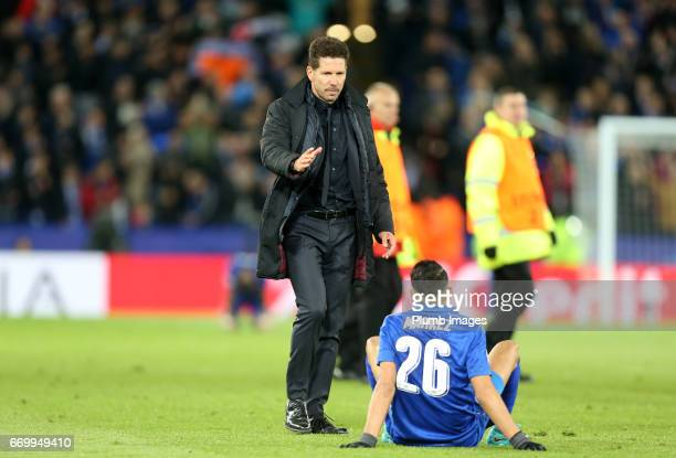 Manager Diego Simeone of Atletico Madrid with Riyad Mahrez of Leicester City after the UEFA Champions League Quarter Final Second Leg match between...