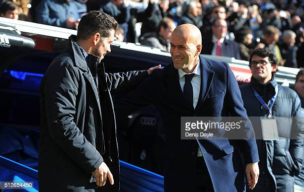 Manager Diego Simeone of Club Atletico de Madrid greets Real Madrid manager Zinedine Zidane during the La Liga match between Real Madrid CF and Club...