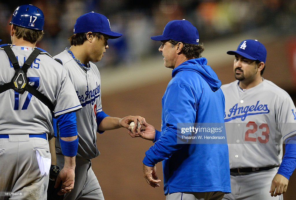 Manager <a gi-track='captionPersonalityLinkClicked' href=/galleries/search?phrase=Don+Mattingly&family=editorial&specificpeople=204707 ng-click='$event.stopPropagation()'>Don Mattingly</a> #8 of th Los Angeles Dodgers takes the ball from pitcher Hyun-Jin Ryu #99 taking him out of the game in the eighth inning against the San Francisco Giants at AT&T Park on September 24, 2013 in San Francisco, California.