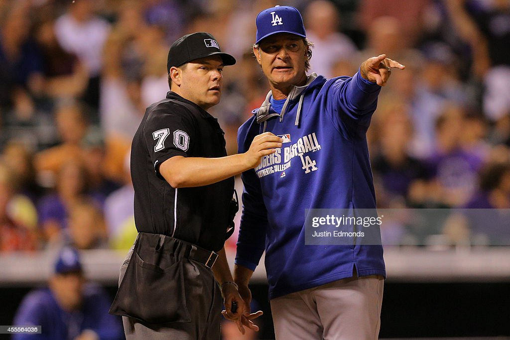 Manager Don Mattingly of the Los Angeles Dodgers argues a call with home plate umpire D.J. Reyburn during the sixth inning of a game against the Colorado Rockies at Coors Field on September 16, 2014 in Denver, Colorado.
