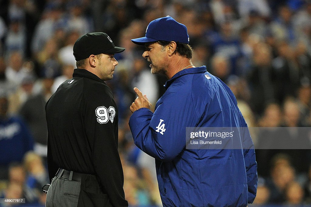 Manager Don Mattingly of the Los Angeles Dodgers argues with umpire Will Little in the sixth inning against the San Francisco Giants at Dodger Stadium on May 9, 2014 in Los Angeles, California.