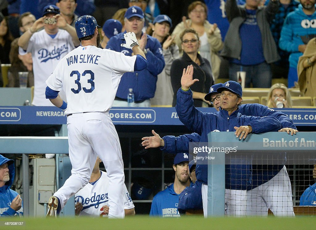 Manager <a gi-track='captionPersonalityLinkClicked' href=/galleries/search?phrase=Don+Mattingly&family=editorial&specificpeople=204707 ng-click='$event.stopPropagation()'>Don Mattingly</a> #8 of the Los Angeles Dodgers celebrates the homerun of <a gi-track='captionPersonalityLinkClicked' href=/galleries/search?phrase=Scott+Van+Slyke&family=editorial&specificpeople=9008639 ng-click='$event.stopPropagation()'>Scott Van Slyke</a> #33 to tie the Arizona Diamondbacks 1-1 during the seventh innin at Dodger Stadium on April 18, 2014 in Los Angeles, California.