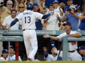 Manager Don Mattingly of the Los Angeles Dodgers congratulated Hanley Ramirez for his homerun to tie the score 22 against the San Diego Padres during...