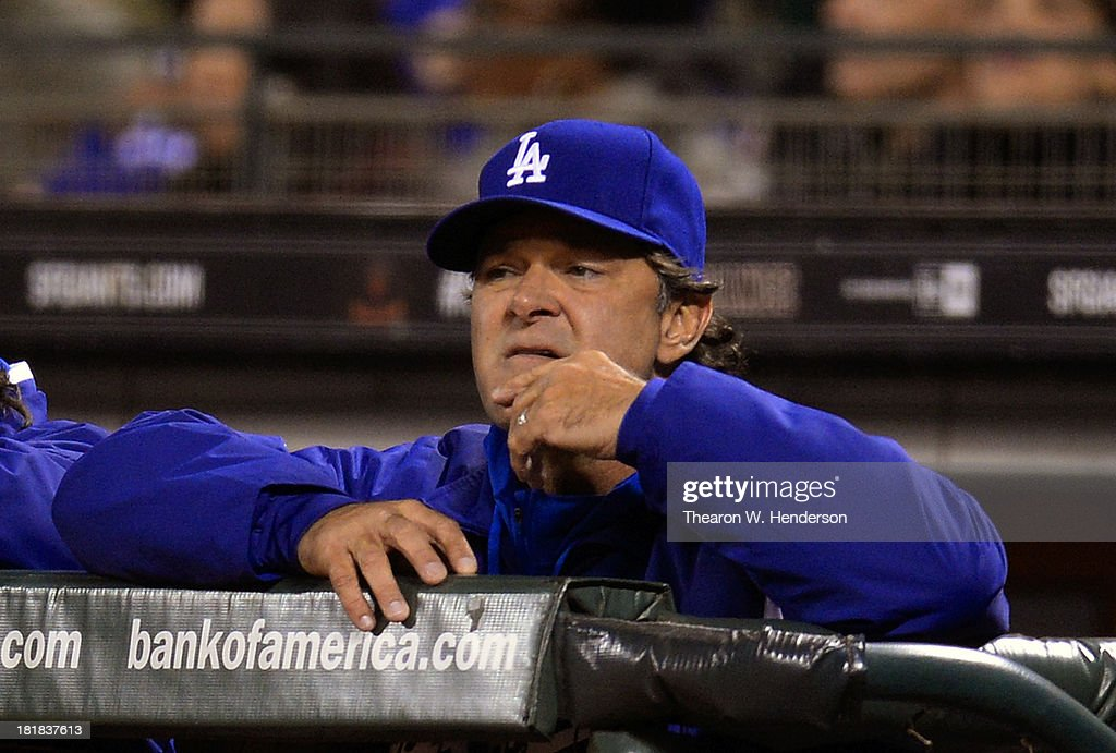 Manager <a gi-track='captionPersonalityLinkClicked' href=/galleries/search?phrase=Don+Mattingly&family=editorial&specificpeople=204707 ng-click='$event.stopPropagation()'>Don Mattingly</a> #8 of the Los Angeles Dodgers gives signals to his catcher during the fifth inning against the San Francisco Giants at AT&T Park on September 25, 2013 in San Francisco, California.