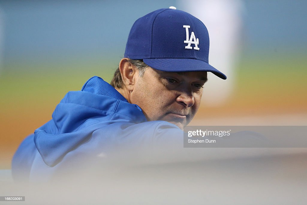 Manager <a gi-track='captionPersonalityLinkClicked' href=/galleries/search?phrase=Don+Mattingly&family=editorial&specificpeople=204707 ng-click='$event.stopPropagation()'>Don Mattingly</a> of the Los Angeles Dodgers looks on from the dugout during the game with the Arizona Diamondbacks at Dodger Stadium on May 6, 2013 in Los Angeles, California.