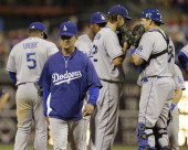 Manager Don Mattingly of the Los Angeles Dodgers walks away from the pitcher's mound after a meeting during the eighth inning against the...