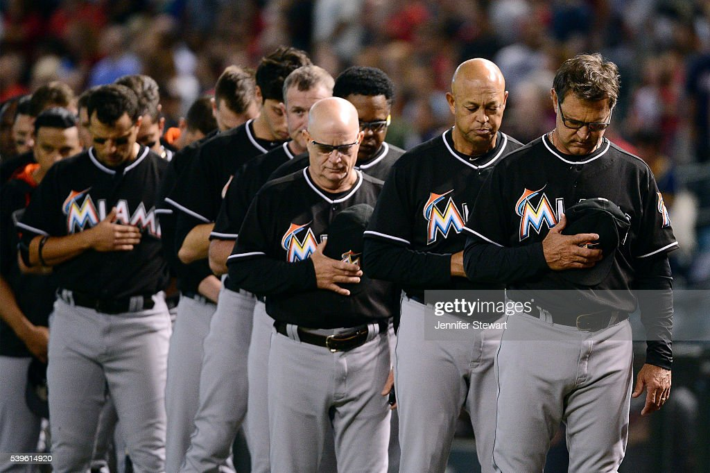 Manager Don Mattingly of the Miami Marlins stands with his team to observe a moment of silence for the victims in the Pulse nightclub terror attack...