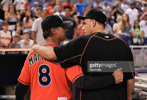 Manager Don Mattingly walks with his arm around Jose Fernandez of the Miami Marlins after the game against the Chicago Cubs at Marlins Park on June...