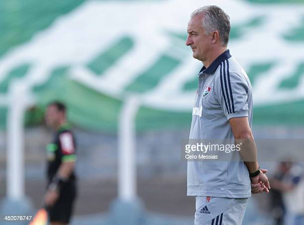 Manager Dorival Junior of Fluminense Manager watches the game during the match between Fluminense and Santos for the Brazilian Series A 2013 at Paulo...