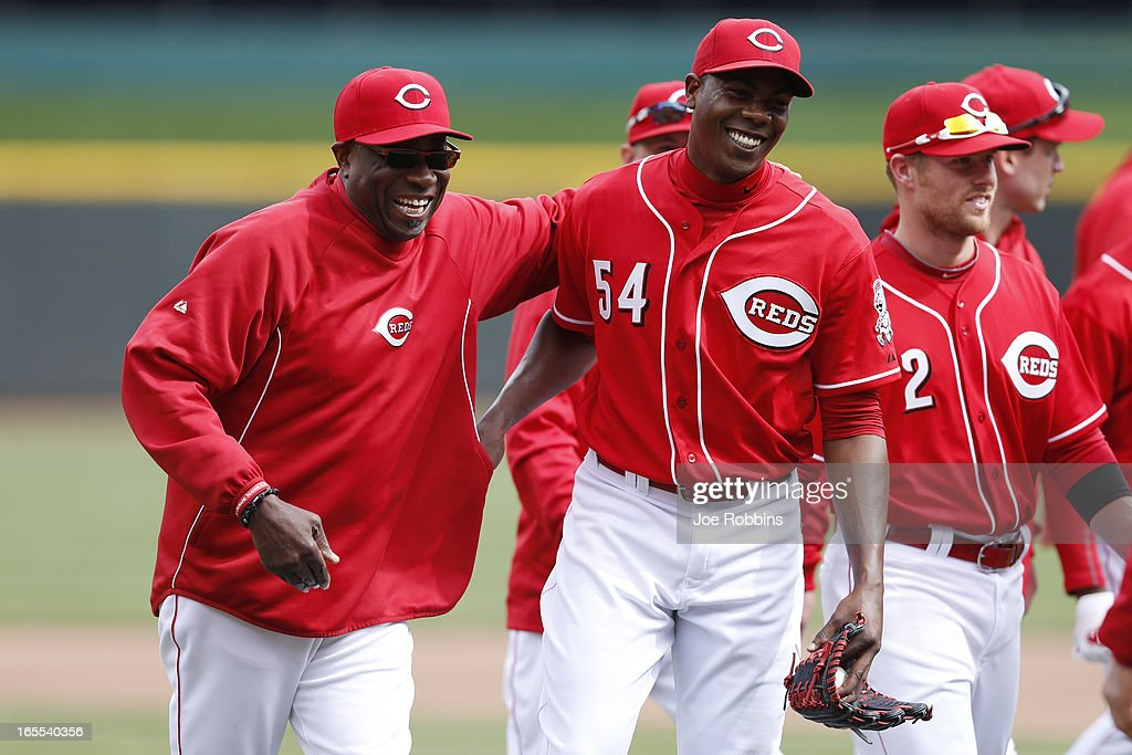 Manager Dusty Baker and Aroldis Chapman #54 of the Cincinnati Reds celebrate after the final out of the game against the Los Angeles Angels of Anaheim at Great American Ball Park on April 4, 2013 in Cincinnati, Ohio. The Reds won 5-4.